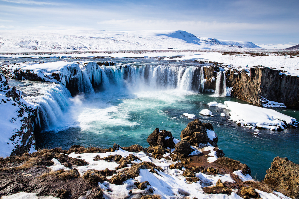 Iceland's Godafoss waterfall covered in April snow