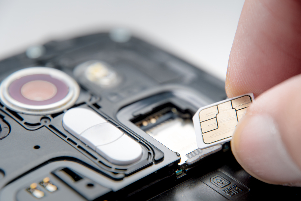 Inserting Iceland SIM card for best mobile coverage