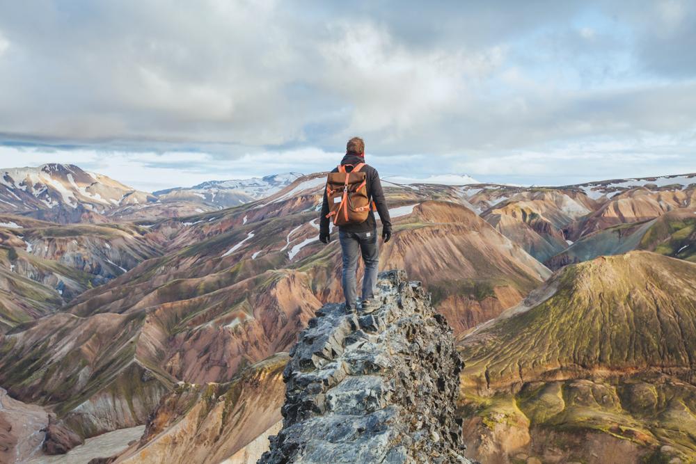 Man ejoying Landmannalaugar, one of the best sights of Iceland