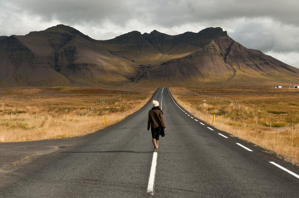 girl walking through a deserted area