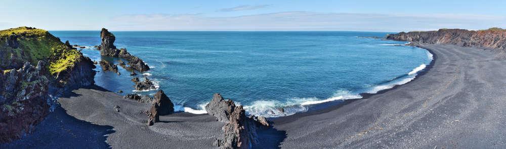 beautiful black sand beach with deep blue sea